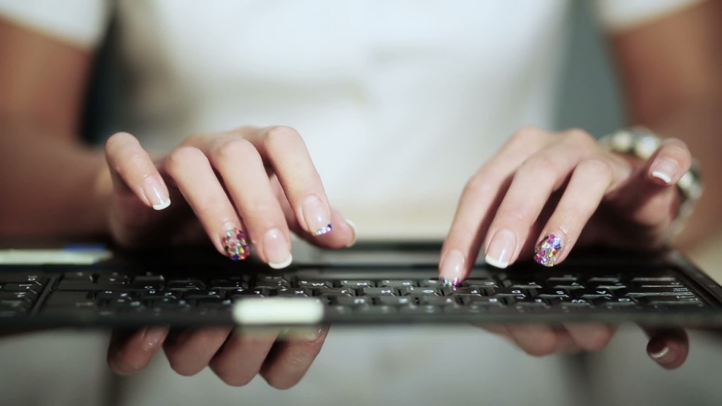 stock-footage-woman-typing-laptop-keyboard-close-up-canon-d-mk-iii